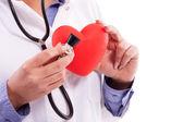 Doctor holding heart — Stock Photo