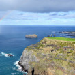 Azores, Sao Miguel, Mosteiros, the western coast of the island in the sea cliffs, rainbow - Stock Photo