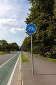 Bike lane with sign — Stock Photo