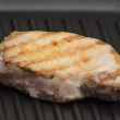Grilled meat on the grill pan — Stock Photo
