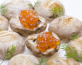 Grilled mushrooms with red caviar — Stock Photo