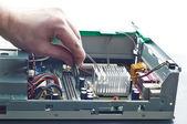 Human hand inserting RAM memory into computer during repair — Stock Photo