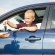 Happy child showing keys from car — Stock Photo