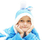 Child in blue bathrobe — Stock Photo