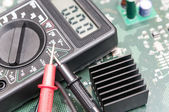Close-up multimeter on PCB plate. — Stock Photo