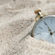 Pocket watch buried in sand — Stock Photo #45726637