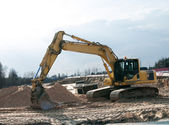 Hydraulic crawler excavator on the construction site — Stock Photo