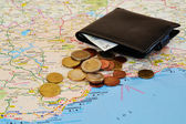 Travel planning: map and cash — Stock Photo