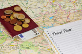 Travel planning: map,notebook, passport and money — Stock Photo