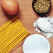 Spaghetti, egg, flour, oregano species — Stock Photo #22036257
