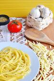Spaghetti, cheese, tomato, oregano and garlic — Stock Photo