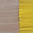 Stock Photo: Spaghetti on wooden background