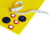 Felt, buttons,measurement on the white background — Стоковое фото