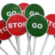 Stop sign among group of go signs — Stock Photo