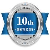 Ten year anniversary badge — Stock Vector