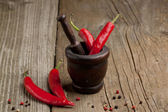Peppers in mortar — Stock Photo