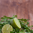 Sliced lime and rukola — Stock Photo