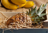 Pineapple in wooden box — Stock Photo