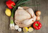 Raw chicken with vegetables — Stock Photo