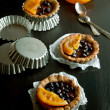 Sweet tartlets with fruit jelly — Stock Photo