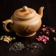 Teapot and dry tea variation — Stock Photo #20033109