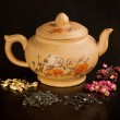 Teapot and dry tea variation — Stock Photo #20033121