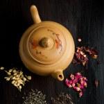 Teapot and dry tea variation — Stock Photo #20033279