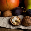 Walnuts and plums — Stock Photo