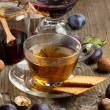 Tea and plums - Stock Photo