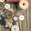 Spools of threads and buttons - Stock Photo