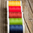 Spools of colorful threads — Stock Photo
