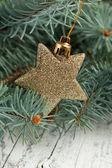 Golden christmas star — Stock Photo