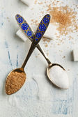 Teaspoons with sugar — Stock Photo