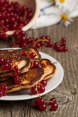 Pancakes with red currant — Stock Photo