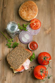 Fresh sandwich with tomatoes, onion and ketchup — Stock Photo