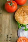 Fresh tomatos and burger's bun — Stock Photo