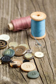 Spools of threads and buttons — Stock Photo