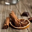 Cinnamon and piece of orange — Stock Photo