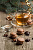 Chocolate macaroons and cup of tea — Stock Photo