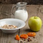 Breakfast with muesli, milk and apple — Stock Photo #20067743