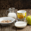 Breakfast with muesli, milk and apple — Stock Photo