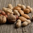 Assorted nuts almond, hazelnut, walnut and peanut — Stock Photo