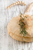 Pita bread with thyme and ears — Stock Photo