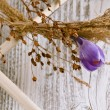 Stock Photo: Dry wreath with purple crocus flower
