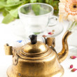 Royalty-Free Stock Photo: Old golden teapot