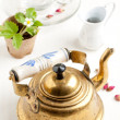 Old golden teapot - Stock Photo