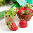 Fresh strawberries and garden tools — Stock Photo