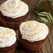 Cupcakes with whipped cream — Stock Photo
