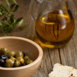 Olive oil with olives and bread - Stock Photo