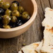 Bowl with olives and bread - Photo